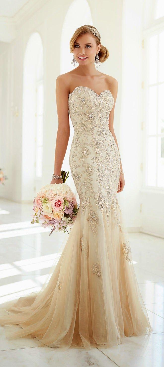 Vestido de novia en blanco con brocado en dorado coleccion de Stella York 2015