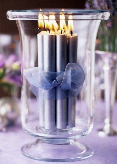 Como hacer centros de mesa para bodas con velas - Velas unidas con una cinta en una hermosa brisera - Fotografia cortesia de Indulgy.com