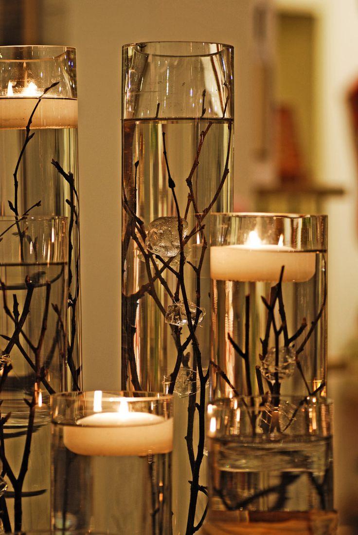 Como hacer centros de mesa para bodas - agua con velas flotantes y ramitas