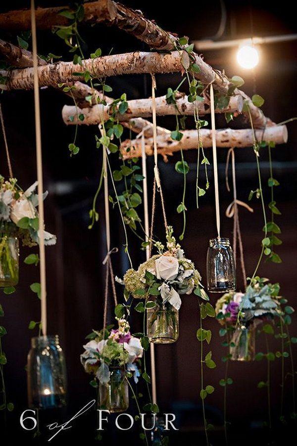 Decoración de bodas con mason jars, ramitas o ramas de árbol.