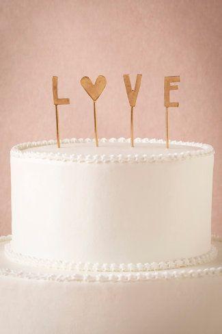 Una boda country merece un cake topper hecho a mano con el toque bohemio perfecto.