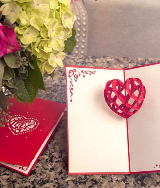 Paper-cut heart pop-up love card