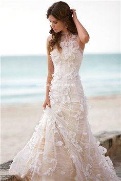 Trumpet dress with halter neckline. Vestidos para novias con corte trompeta y cuello halter, perfecto para una boda en la playa.