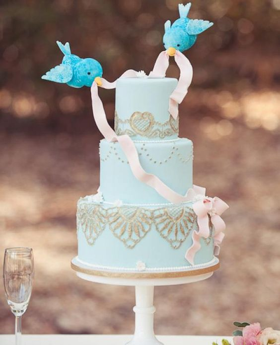 Disney themed wedding cake and cake toppers. Adorable!