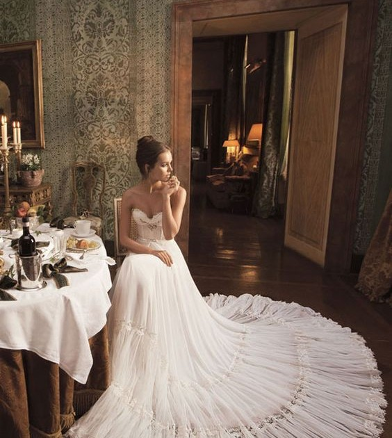 Romantic and feminine creation by Inbal Dror. An amazing example of the white wedding dress.
