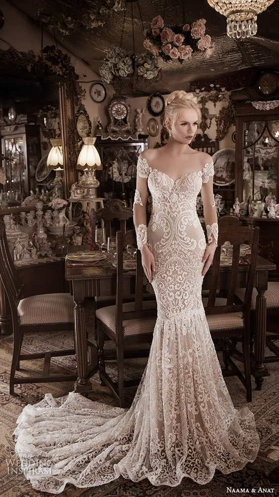 Long sleeve white wedding dress from Naama & Amat fall winter 2016 collection.
