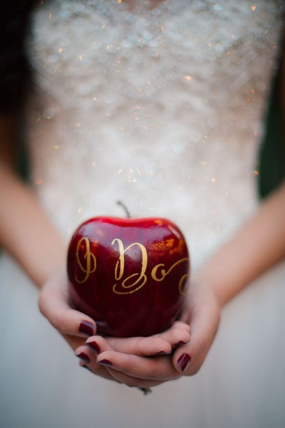 Snow white themed wedding with lots of ruby red apples. Claire Marika Photography.