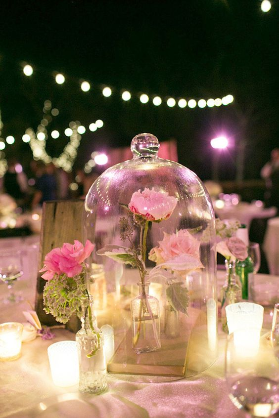 Wedding centerpieces inspired in Disney's Beauty and the Beast.