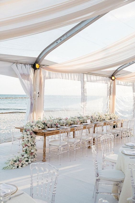 Wedding reception at a Mexico beach captured by Stephen Karlisch Photography. The perfect example of a lavish beach themed wedding.
