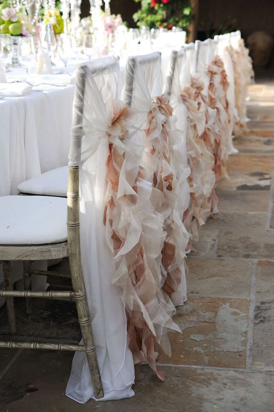 White and blush chair covers. Divine!