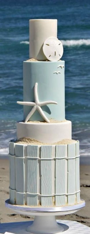 A beautifully surprising 4-tiered beach wedding cake. Get all the inspiration you need to plan and decorate your beach themed wedding!