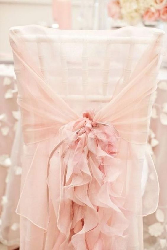 Blush chair covers for romantic blush weddings.