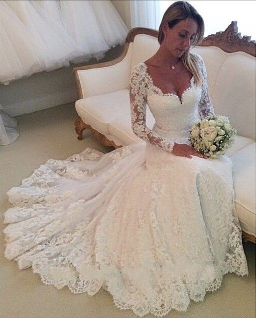 Long sleeve, mermaid, lace white wedding dress with open back. Romantic and vintage.