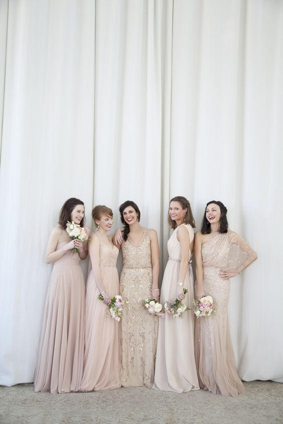 Classically elegant nude blush bridesmaid dresses. Beautiful but simple idea for the bridesmaids: light pink dress with matching flowers.