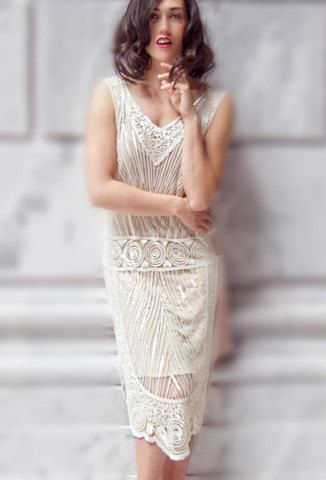Just because it's white it doesn't have to be traditional. Flapper style short wedding gown, perfect for a vintage deco wedding with 1920s flair.