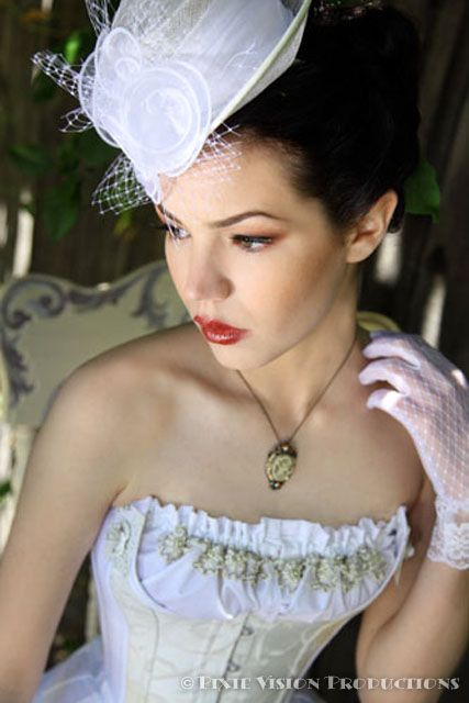 A white wedding dress can also be daring with a touch of steampunk design. Dixie Vision Photography via offbeat Bride.