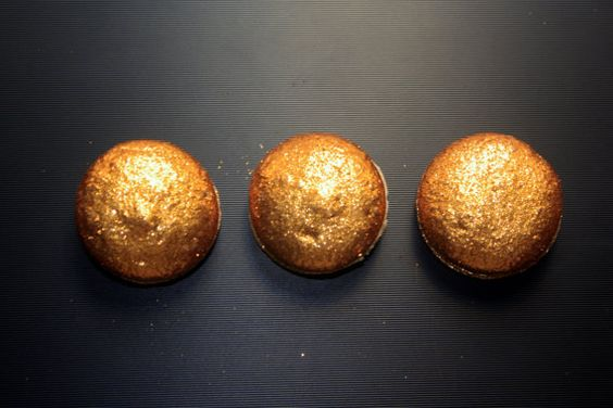 Glittery golden french macarons for a glam wedding.