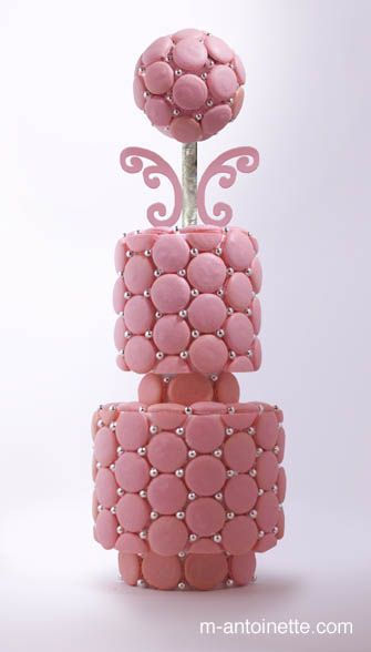 Macaron wedding cake with pearls and tiers in different shapes. Exquisite.
