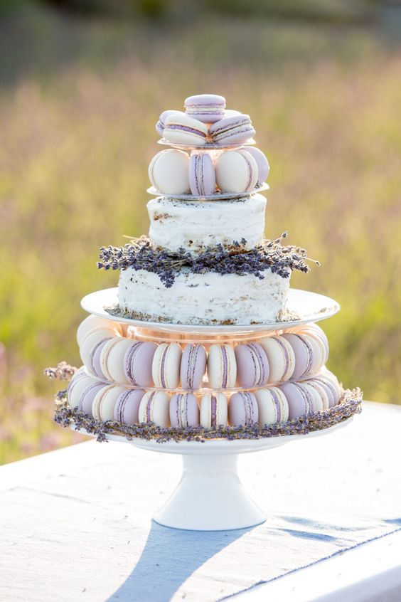 Whimsical and romantic macaron wedding cake. White wedding cake with lavender macarons for a rustic wedding.