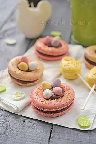 A twist on wedding macarons, as little nests or lollipops.