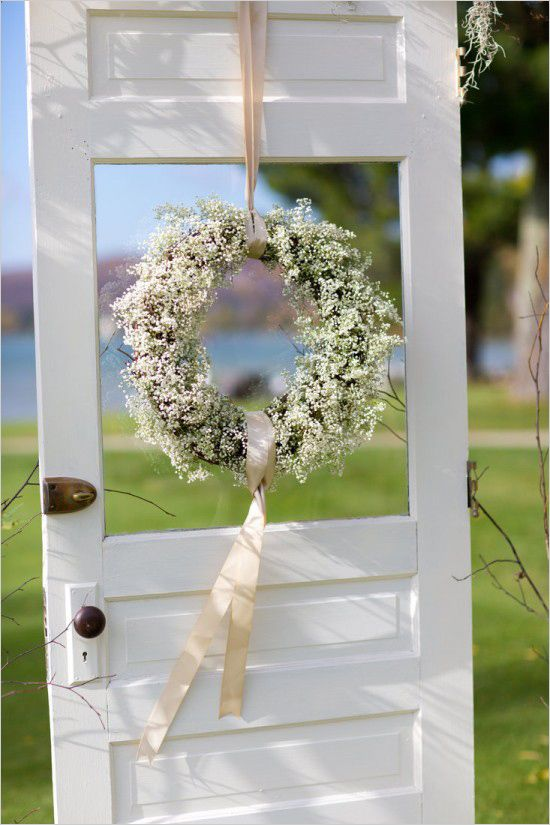 A paniculata wreath hanging from the wedding ceremony door photographed by Stephanie N Baker.