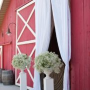 Baby's breath wedding decor for ceremony entrance at this rustic barn wedding.