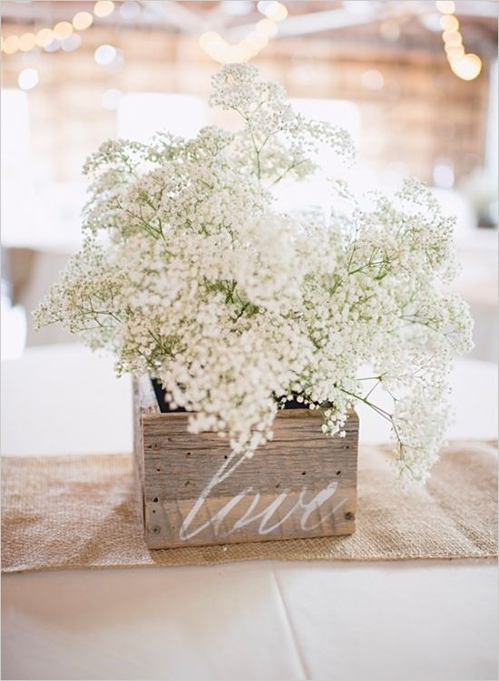 Another great example of baby's breath for an elegant-chic wedding. Simple wooden boxes filled with baby's breath bouquets for striking floral arrangements, not to mention economical and easy to DIY.