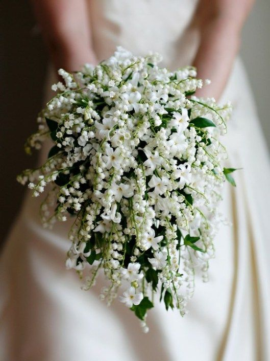 A bridal bouquet with Lily of the valley and filler flowers.