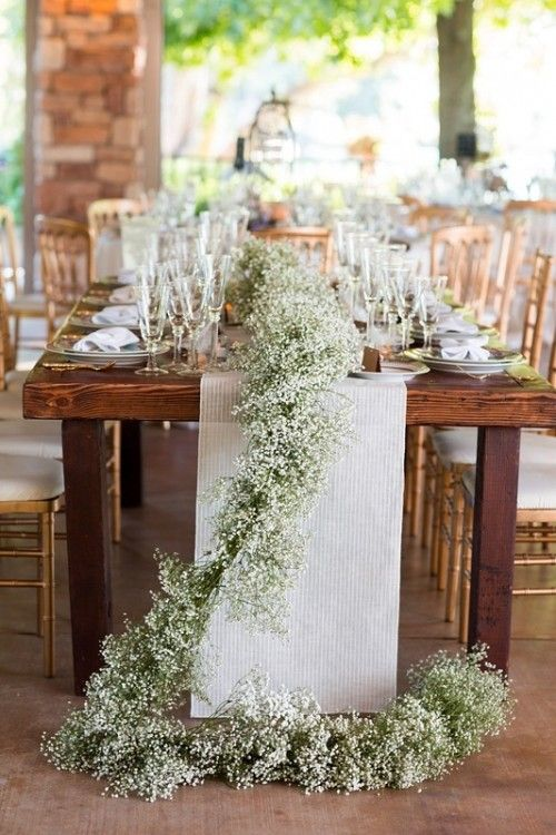 Gypsophila wedding table decorations. Add a garland of baby's breath on top of the wedding table.