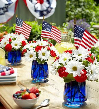A great idea to decorate your tables: 3-color flower bouquets and color-matching candle centerpieces.