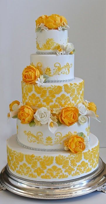 Bright and delicate 5-tiered cake with fresh flowers by Couture Cakery.