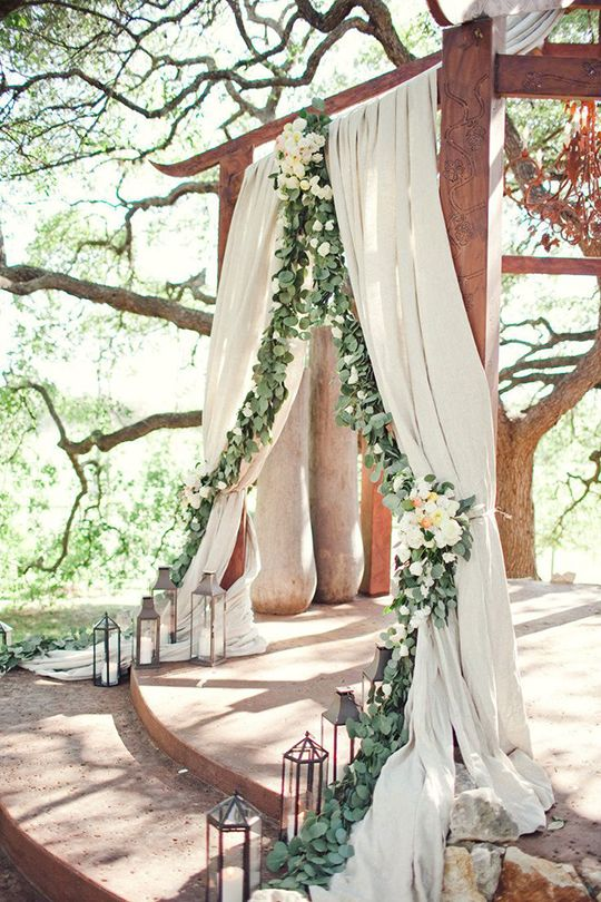 Austin wedding ceremony. Add greenery garland to white sheer curtains. After the ceremony move to wedding party table for reception.