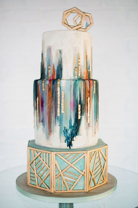 Boho wedding cake by Olofson Design. Incredible combination of watercolor, metallics, and geometric shapes!