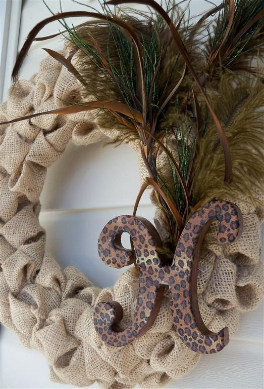 Burlap bubble wreath with feathers and monogram letter.