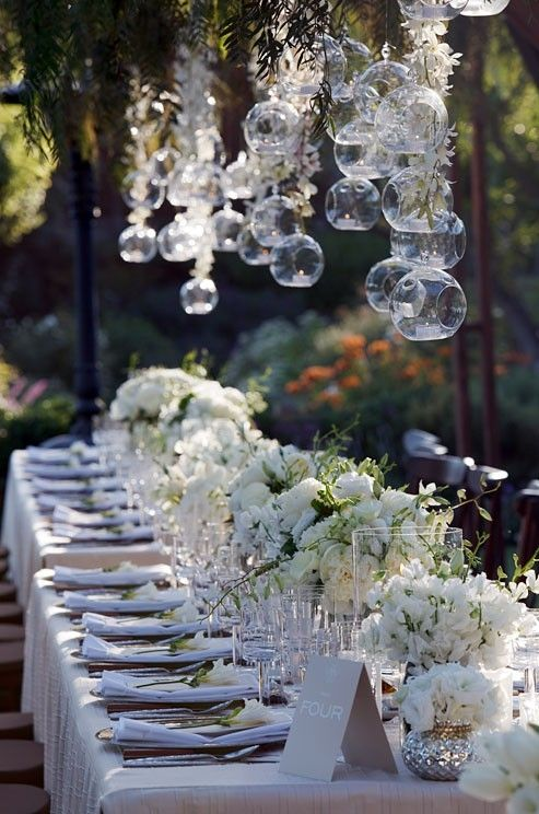 Outdoor Wedding reception decor: floating bubbles with tea lights will give your table a very magical appeal.