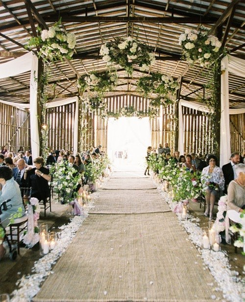 Barn wedding aisle with burlap runner. Love the hanging greenery over the aisle.