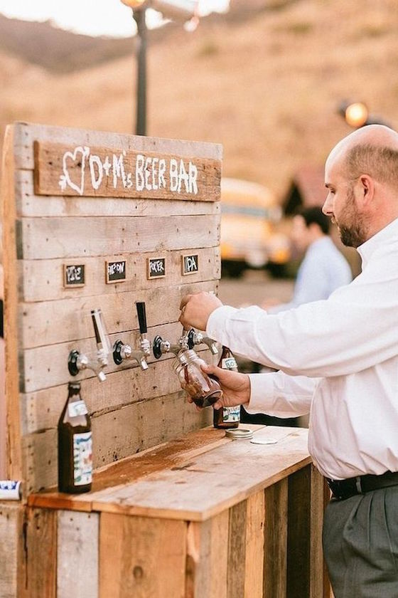 If you're planning a barn wedding, a stylish drink station will get guests mingling while also doubling as decor.