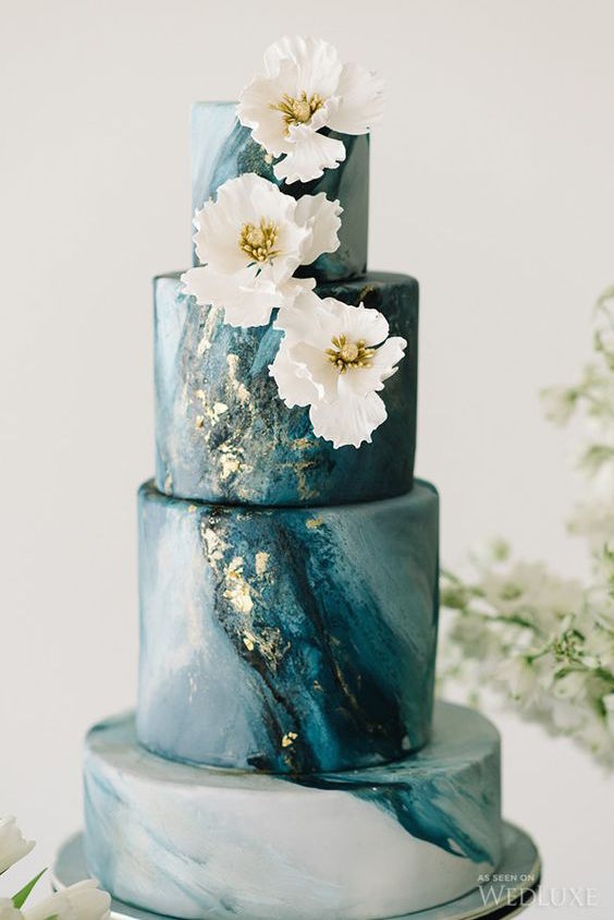 An elegant cake with a geode look captured by Tara McMullen Photography.