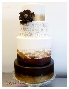 Elegant wedding cakes with four tiers. Write your vows across your cake in gold!