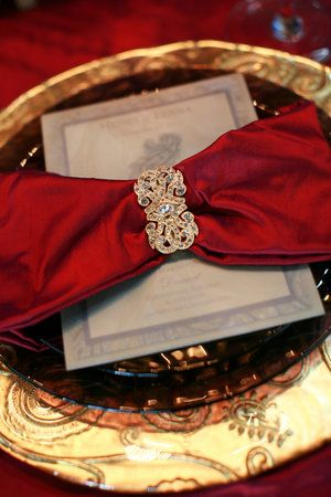 Glam gold wedding: Elegant place settings with red and gold. Deep red and gold embolden the classics. These rich tones will imbue your wedding with a regal air.