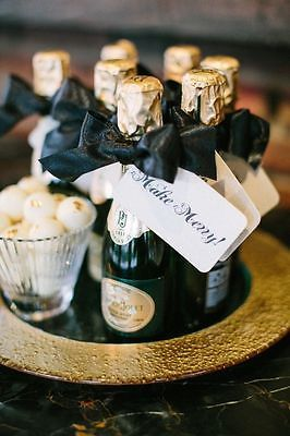 Mini champagne bottles as wedding favors.