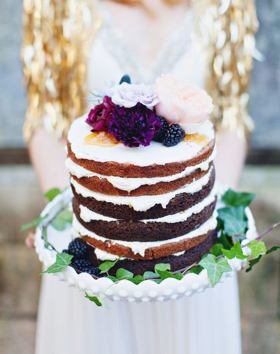 This naked cake with jewels tones has all the airiness of a romantic, lighthearted affair captured by Flora + Fauna + Liz Stewart Floral.
