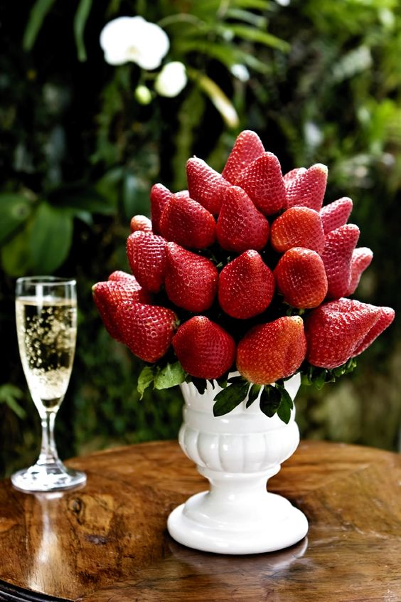 If your wedding is held in a garden, this decorative chocolate fountain idea is pure genius and also really simple to do. Using a rectangular sponge, add strawberries with skewers and cover it completely.