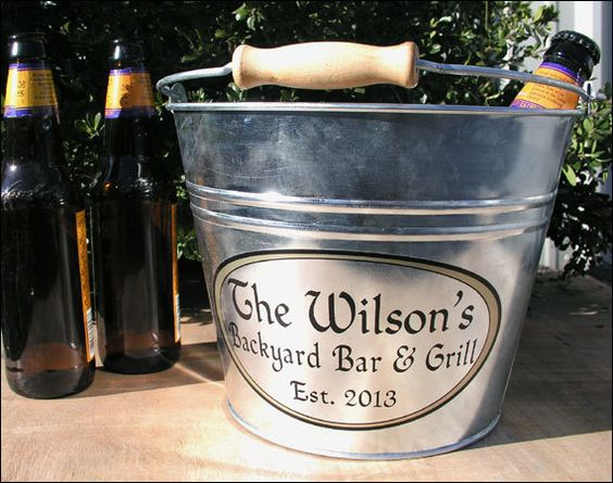 Personalized beer buckets as unforgettable wedding favors.