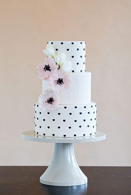 Instead of Swiss dots or polka dots, cake designer Erin Gardner of Wild Orchid Baking Co. decorated the tiers with tiny fondant hearts, which gives the design a preppy-yet-whimsical feel. Photography: Mark Davidson.