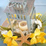 Lemon yellow beach wedding centerpiece.