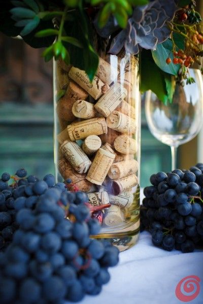 Ultra original and simple wedding centerpieces. Corks in vase.