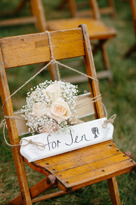 A reserved seat at the ceremony for a lost loved one. Photography: Jacquelyn Poussot Photography
