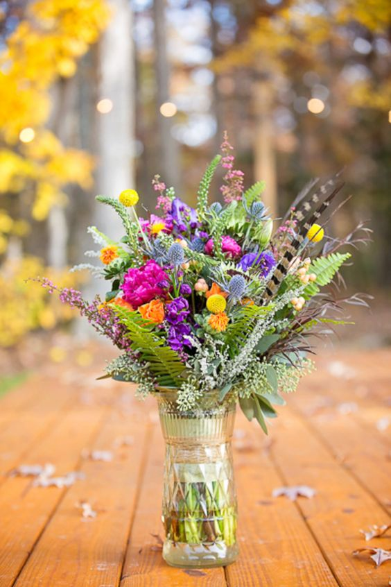 Colorful vintage boho chic wedding arrangement. Leverage the simplicity of seasonal flowers or just pick your very own from the surrounding country side.