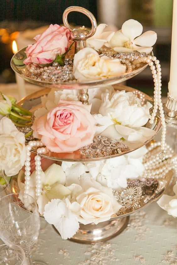 Vintage is the perfect way to describe each of these amazing and affordable wedding centerpieces. Pillar candles, burlap, wildflowers and birdcages.